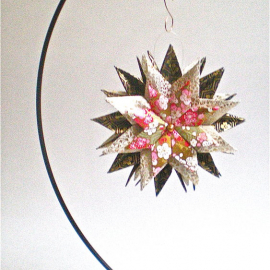 Origami Inspired Origami Inspired Pink Floral Paper Star on an ornament stand